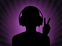 Dj girl in headphones with a peace sign Royalty Free Stock Images