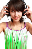 DJ girl with headphones smiling. DJ girl putting her headphones on and smiling stock photography