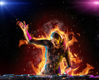 Dj girl mixing electronic music in fire Royalty Free Stock Photo