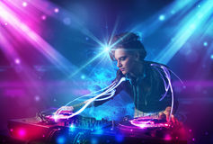 Dj girl mixing music with powerful light effects Royalty Free Stock Image