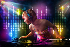Dj girl playing songs in a disco with light show Stock Images