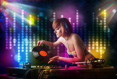 Dj girl playing songs in a disco with light show Stock Photography