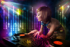 Dj girl playing songs in a disco with light show Royalty Free Stock Photography