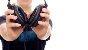 DJ giving headphones Royalty Free Stock Photos