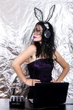 DJ halloween girl woman headpgone mask black celebrate corset costume fun brunette playing mixing purple lace royalty free stock photos