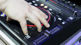 Dj hand. Spinning on cd player royalty free stock images