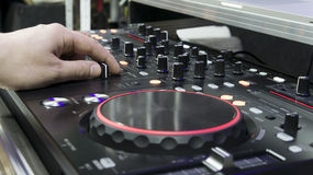Dj hand. Spinning on cd player stock photography