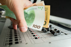 DJ hand with currency Royalty Free Stock Photography