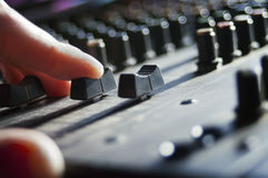 DJ hand over a mixer Royalty Free Stock Images