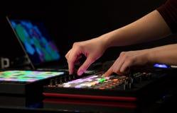 Hand mixing music on midi controller. Dj hand remixing music on midi controller stock photo