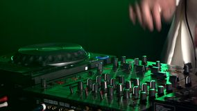 Dj hands on equipment deck, dancing and playing stock footage