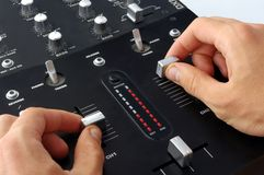 Dj hands on mixer Stock Photo