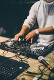 DJ hands playing mixing music at night party. DJ hands playing mixing music at night party royalty free stock image
