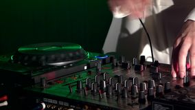 Dj hands on stylish equipment deck, dancing and stock video footage