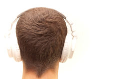 Dj head from beside. Dj head with white headphones from beside Royalty Free Stock Photography