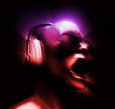 DJ with Headphones. DJ yelling with Headphones multi-colored 3D illustration on black background Royalty Free Stock Images