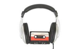 Dj headphones and audio cassette Stock Photos