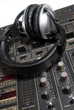 Dj headphones on mixer Stock Photo
