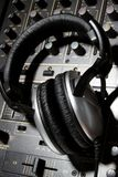 Dj headphones on mixer Royalty Free Stock Image