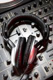 Dj headphones on mixer Stock Photography