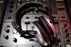 Dj headphones on mixer Stock Photo