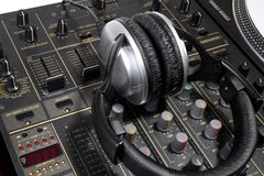 Dj headphones on mixer Stock Images