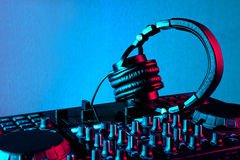 Dj headphones and mixer. Dj mixer with headphones at nightclub Royalty Free Stock Photography