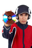 DJ holding a disc. Disc Jockey holding a compact disc over a white background. Focus on CD Stock Image