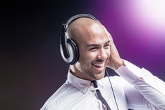 Dj holding his headphones Royalty Free Stock Images