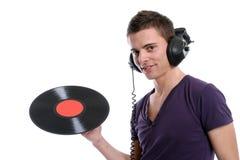 DJ in hoofdtelefoons die een plaat verdraaien Stock Foto's
