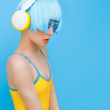 DJ-lady in style headphones listening to music Stock Images