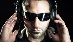 Dj listening music Stock Photos