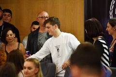 Dj Martin Garrix signs autographs for fans at a press conference. CLUJ-NAPOCA, ROMANIA - AUGUST 8, 2016: Dutch Dj, record producer and musician Martin Garrix Stock Image