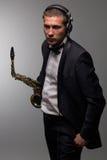 DJ met saxofoon Stock Afbeelding