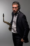 DJ mit Saxophon Stockbild