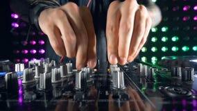 A DJ mixer adjustment process in detail. stock video