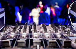 DJ mixer box and party crowd royalty free stock photo