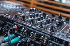 DJ mixer in bright colors disco in a nightclub. Stock Photo