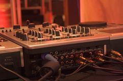 DJ Mixer controls. Professional DJ mixer controls and ports at a nightclub royalty free stock photography
