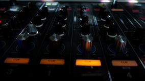 Dj mixer HD video. Dj mixes the track in the nightclub at party. Static HD video of mixes it is poured in different colors