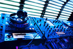 Dj mixer with headphones. At a nightclub Stock Photography