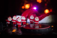 Dj mixer with headphones on dark nightclub background with Christmas tree New Year Eve. Close up view of New Year elements or symb Royalty Free Stock Photography