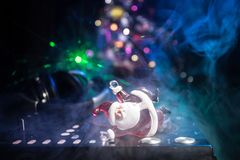 Dj mixer with headphones on dark nightclub background with Christmas tree New Year Eve. Close up view of New Year elements on a Dj stock photos