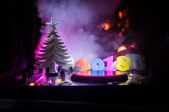 Dj mixer with headphones on dark nightclub background with Christmas tree New Year Eve. Close up view of New Year elements or symb royalty free stock photos