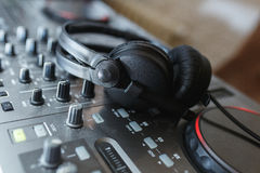 DJ Mixer with headphones. Royalty Free Stock Images
