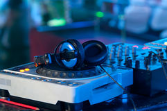 Dj mixer with headphones at a nightclub Stock Photography