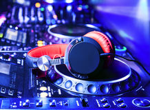 Dj mixer with headphones. At nightclub Royalty Free Stock Photos