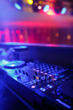 DJ mixer with light colored spotlights discos Stock Photos
