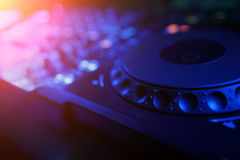 DJ mixer with light colored spotlights discos Royalty Free Stock Photos