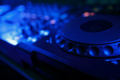 DJ mixer with light colored spotlights discos Stock Photography